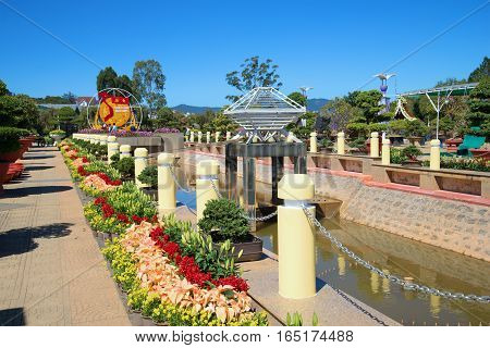 DA LAT, VIETNAM - DECEMBER 27, 2015: The avenue with lilies in the flower park of Da Lat