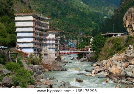 MANIKARAN, INDIA - MAY 13, 2011: Hotel for Sikh pilgrims over the mountain Parvati river in Manikaran. The State Of Himachal Pradesh, North India