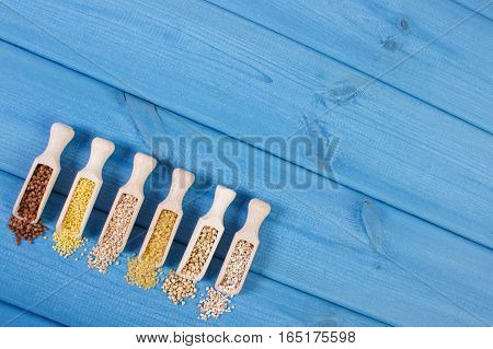 Various Groats On Wooden Spoons, Healthy Food And Nutrition, Copy Space For Text