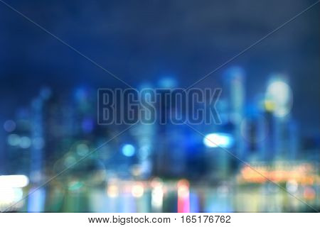 abstract light bokeh of night cityscape of waterfront in singapore - can use to display or montage on product