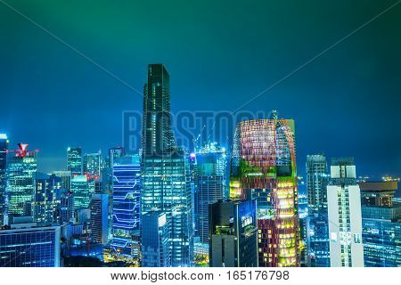 abstract night cityscape in singapore with green aurora filter - can use to display or montage on product
