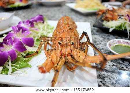 lobster with garilc on table. . .