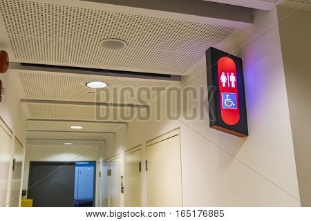 abstract conner of toilet sign and fire exit way on the wall - can use to display or montage on product