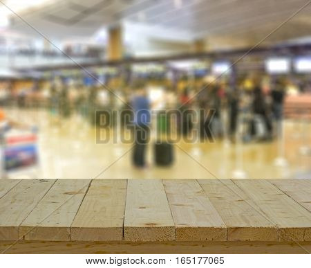 wood table top on abstract blur background of counter checkin at airport - can use to display or montage on product