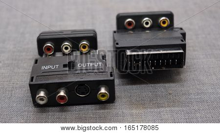 Male SCART AV black plastic adaptor isolated over the white background set of three different foreshortenings