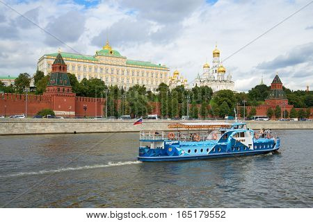 MOSCOW, RUSSIA - SEPTEMBER 07, 2016: Pleasure excursion boat on the Moscow river on the background of the Kremlin. Moscow, Russia