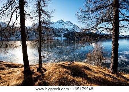 Frozen Mountain Lake In Winter Sunny Day