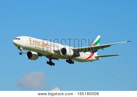 SAINT PETERSBURG, RUSSIA - AUGUST 24, 2016: The Boeing 777-300 (A6-EGU) Emirates Airline companies plane on a glide path