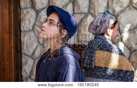 QUMRAN ISRAEL - JANUARY 06 2017: jewish orthodox boy and his mom