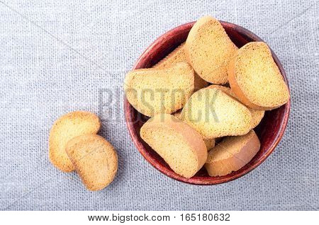 Pieces Of Rusk In The Old Brown Wooden Bowl