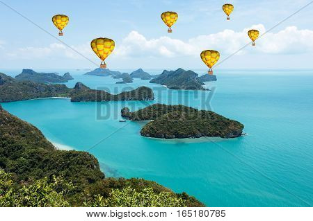 Colorful hot-air balloons flying over the sea