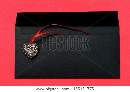 Metallic Heart shaped decoration on postal envelope