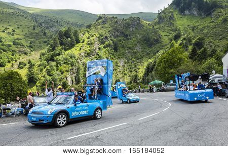 Col du Tourmalet, France - July 24, 2014: Krys caravan during the passing of the Publicity Caravan on the road to Col de Tourmalet in the stage 18 of Le Tour de France 2014.