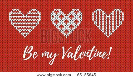 Seamless pattern on the theme of holiday Valentine's Day with an image of the Norwegian and fairisle patterns. White hearts and inscription Be my Valentine on a red background. Wool knitted texture. Vector Illustration