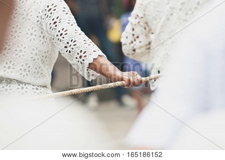 People harmony in pulling the rope with hand on The End of Buddhist Lent Day in Chak Phra Festival (Pulling the Buddha ) from Surat Thani ( Thailand )