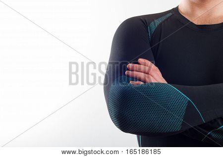 Man wearing black thermal base layer underwear on white background