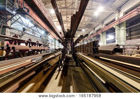 Many type of old rustic steel and iron. Stack of steel pipes. Workshop on production of handling removable devices.