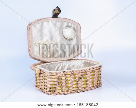 Picture of the opened beige-coloured box for needlework isolated on white background. Handmade decoupage box for needlework.