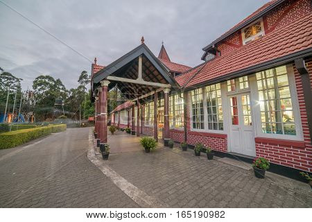 Sri Lanka, Nuwara Eliya: colonial British post office at sunset