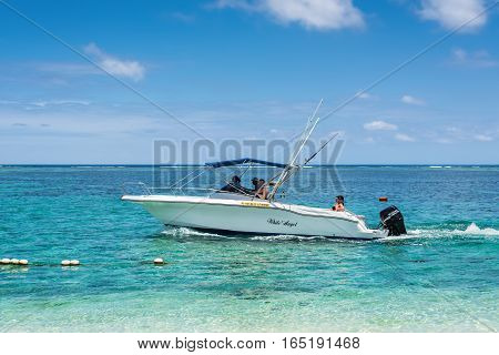 Le Morne Mauritius - December 7 2015: Speed boat on the Le Morne Beach one of the finest beaches in Mauritius and the site of many tourism facilities.