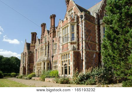Detail of the South facing elevation of Aldermaston Manor Berkshire. The historic stately home which was extensively rebuilt in the Victorian era dates from Stuart times and is now empty awaiting redevelopment.