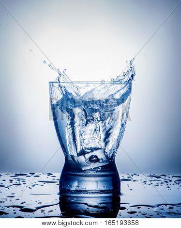 Splash in a glass on gradient background