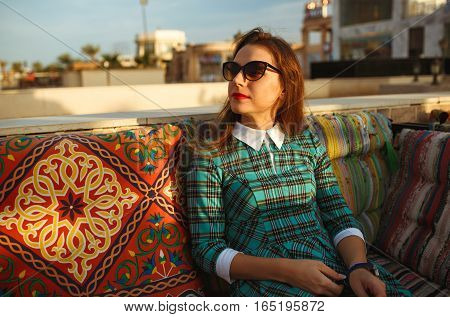 Beautiful young woman relaxes in a cafe in Egypt