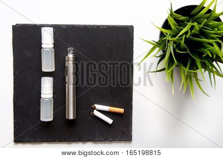 concept of electronic cigarette on white background top view.