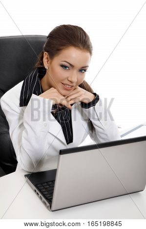 Young business woman with computer. Business concept.