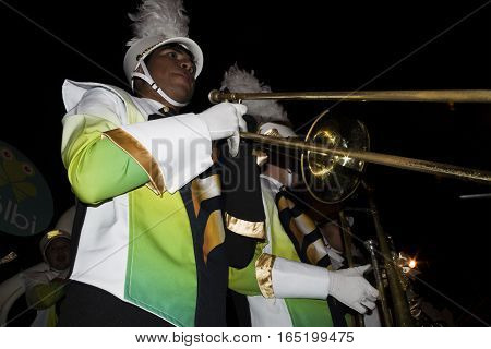 SAN JOSE, COSTA RICA - December 18: Marching band musicians playing trombone  during the Festival of Light Parade whichl is part of Christmas and holiday season Festivities in Costa Rica. December 18, 2016 in San Jose.