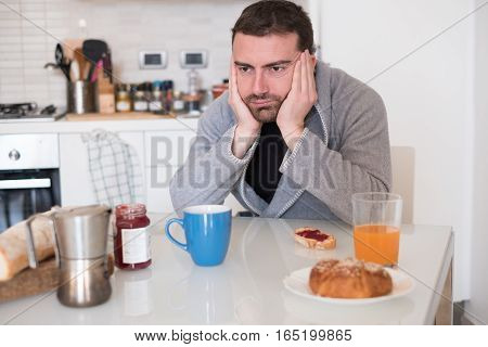 Tired Man Feeling Bad During The Morning Breakfast