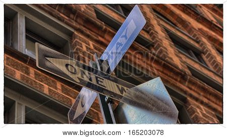 Street signs of New York on a brown building background