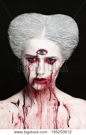 Mysterious Beauty Portrait Of Snow Queen Covered With Blood. Bright Luxury Makeup. Gore Dripping Fro