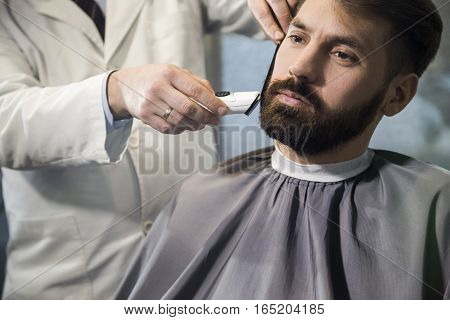 Close Up Of A Man Having His Hair Cut