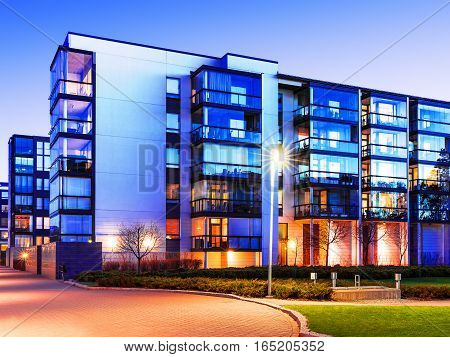 Evening outdoor urban view of modern real estate homes