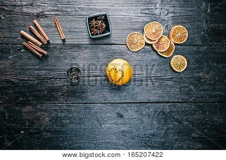 Heart-shaped pomander of orange and cloves on the table. Overhead view