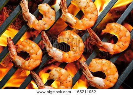 Closeup grilled shrimps,prawns on the flaming grill