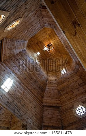 Wooden church from the inside. The wooden dome of the old temple.