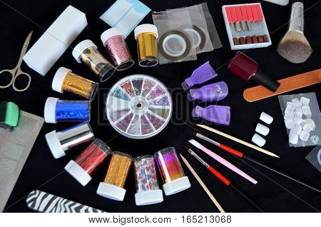 Tools for manicure on a black background accessories in the beauty salon.