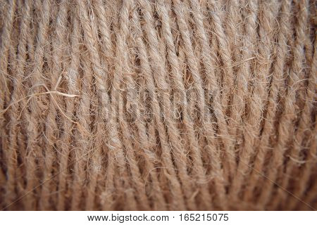 background from a hank of a cord, a string of beige color. macro, contrast