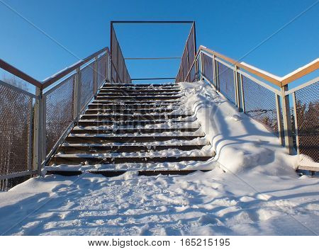 The footbridge over railway covered with snow