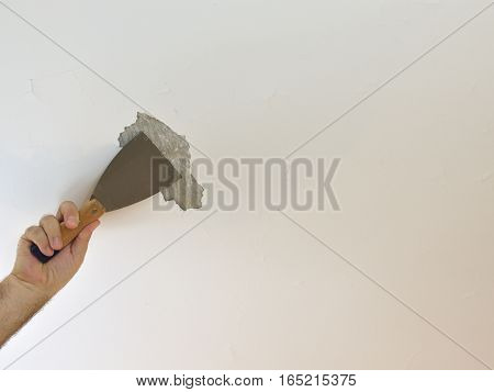 Hand With A Plaster Spatula