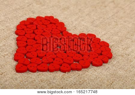 Red Heart Shaped Sewing Buttons On Canvas