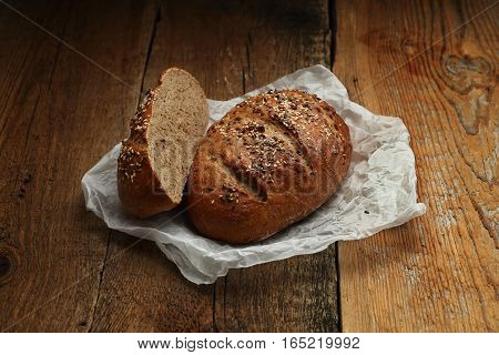 Bread With Butter-paper On Wooden Background