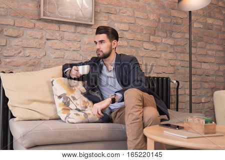 Young Handsome Man Enjoying Coffee Espresso Indoors Interior