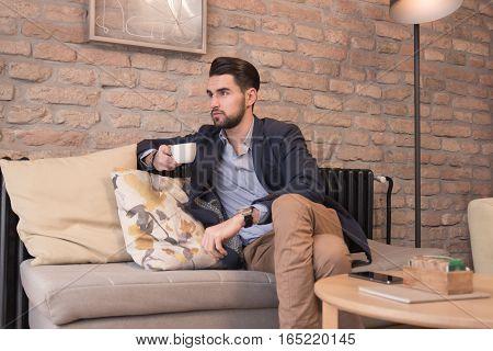 Young Handsome Man Enjoying Coffee Espresso Indoors Interior