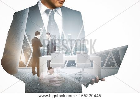 Young man with laptop thinking about work meeting. Double exposure. Business concept