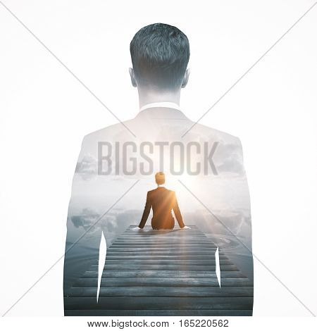 Back view of thoughtful businessperson sitting on pier and looking into the distance. Research concept. Double exposure