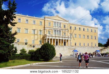 ATHENS - SEPTEMBER 9: People walk around the Greece parliament on Syntagma square on summer sunny day on the 9th of September, 2016 in Athens.