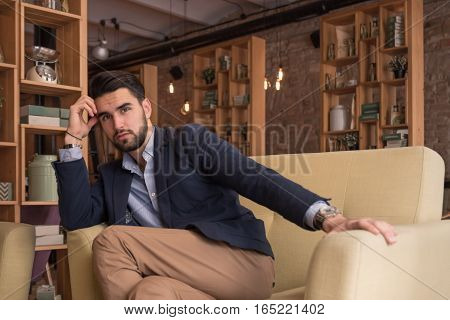 Young Handsome Man Sitting Sofa Cafe